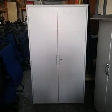 White wooden cupboard with 4 shelves