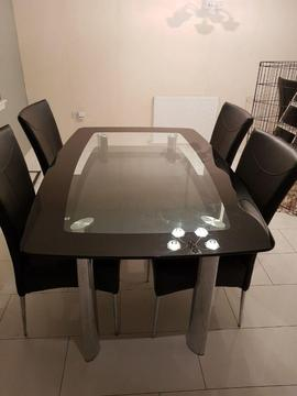 Metal and glass dining table