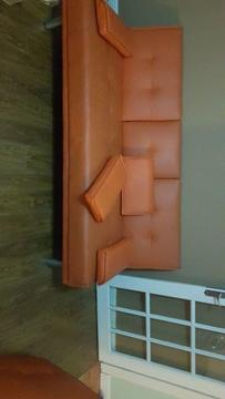 FREE ORANGE FAUX LEATHER SOFA BED WITH DRINK HOLDER