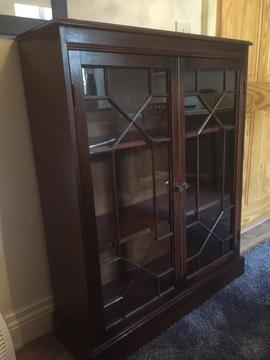 Wooden cabinet with glass doors and detail