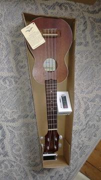 Brand new Aquila Ukelele and tuner for sale. Still in its original box, ideal for beginners