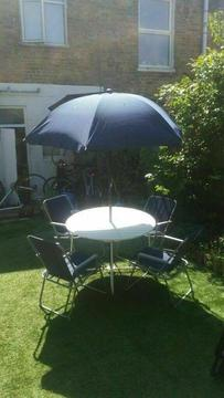 set for garden white foldinng table 4 blue folding table and blue umbrella good condition